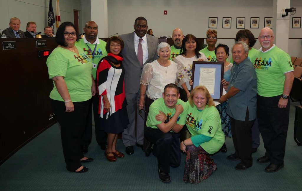 Filipino Americans and the Brevard County Diversity Team with the proclamation.